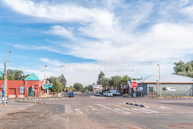 Street scene in Keimoes. KEIMOES, SOUTH AFRICA - JUNE 12, 2017: A street scene with businesses and vehicles in Keimoes in the Northern Cape Province royalty free stock photos