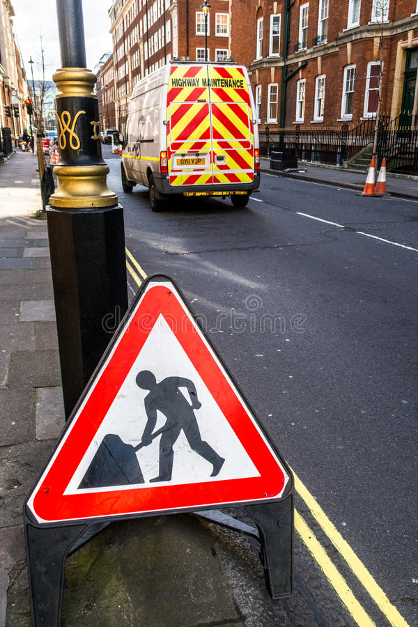A street scene in London men at work royalty free stock photos