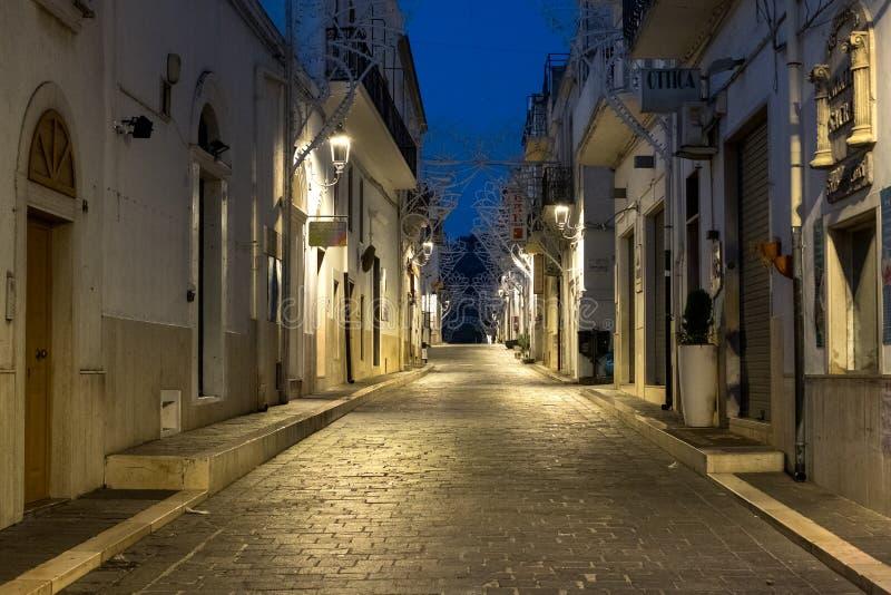 Street scene in Mattinata, on the Adriatic coast in the Gargano Peninsula, Puglia, Italy. Photographed at night in late summer. stock photography