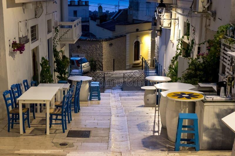 Street scene in Mattinata, on the Adriatic coast in the Gargano Peninsula, Puglia, Italy. Photographed at night in late summer. The Gargano Peninsula stock images
