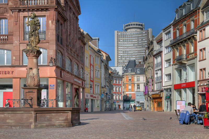 Street scene in Mulhouse, France. Quiet Sunday in downtown Mulhouse, France. View along pedestrian Rue Merciere, with the Europe Tower (Tour de l'Europe) in the royalty free stock photo