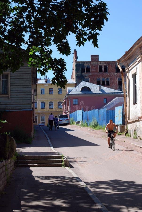 Street scene at noon with natives in old Vyborg neighbourhood. VYBORG, RUSSIA - JULY 10, 2016: Street scene at noon with natives in one of the old fashioned stock photo