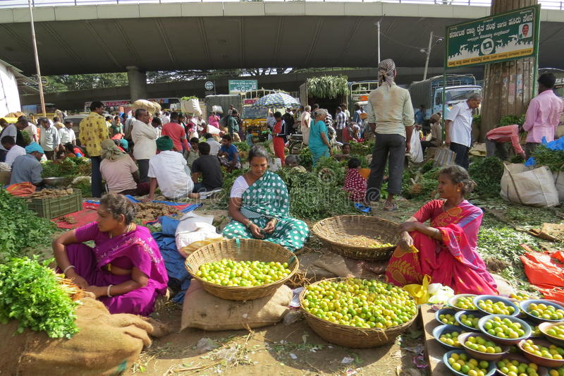 Street scene outside of KR market,Bangalore. Fruits and vegetable sellers on the street royalty free stock photo