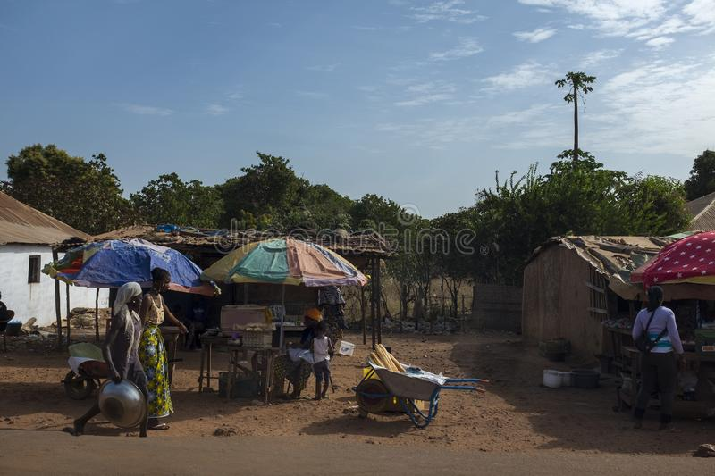 Street scene in the outskirts of the city of Bissau with street vendors, in Guinea-Bissau. Bissau, Republic of Guinea-Bissau - February 7, 2018: Street scene in royalty free stock photos