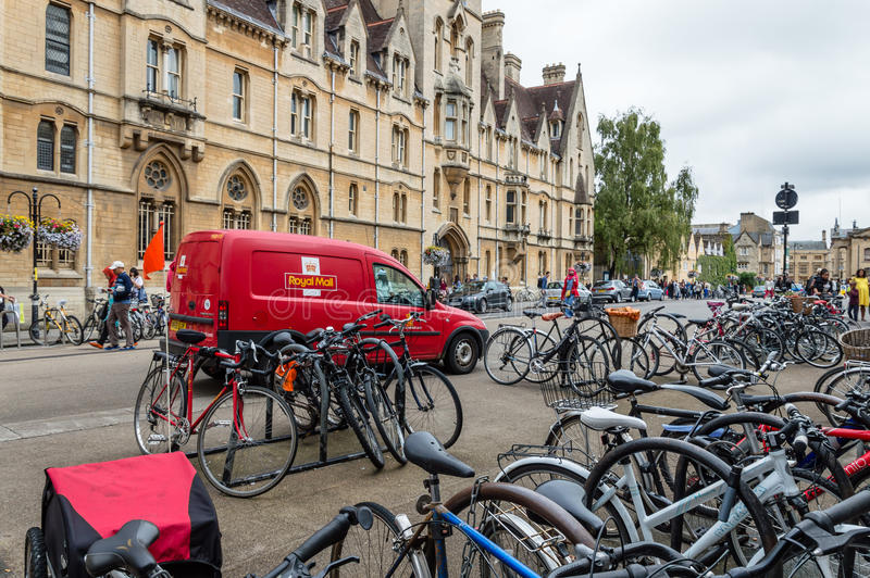 Street scene in Oxford. Oxford, UK - August 12, 2015: Broad Street in Oxford. Street scene with bicycles parked a cloudy day. The street is known for its royalty free stock image