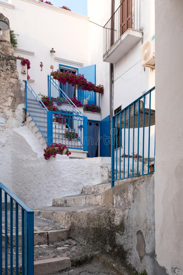 Street scene in the picturesque Puglian town of Peschici on the Gargano Peninsula, Southern Italy. Peschici is in the Foggia Province royalty free stock image