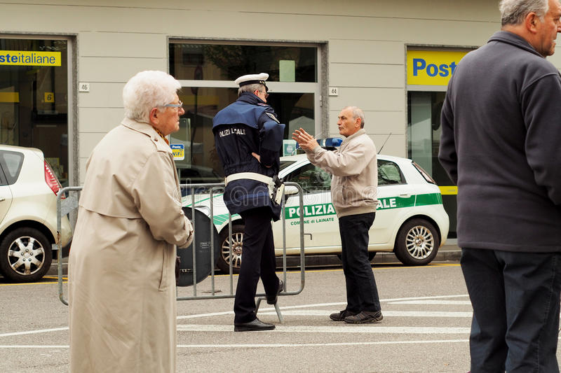 Street scene with police talking with citizen. stock photo