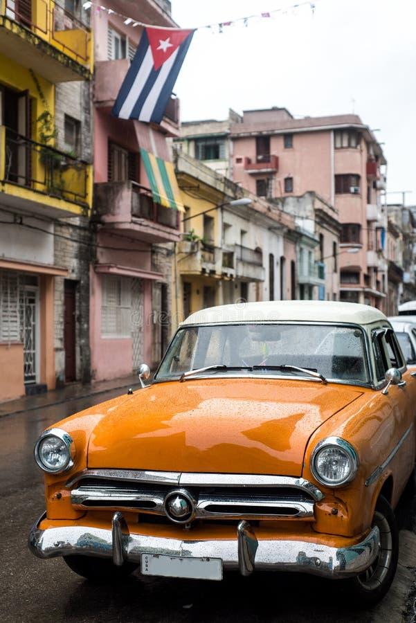Street scene on rainy day in Havana,Cuba. Street scene with old car on rainy day in Havana,Cuba royalty free stock photo