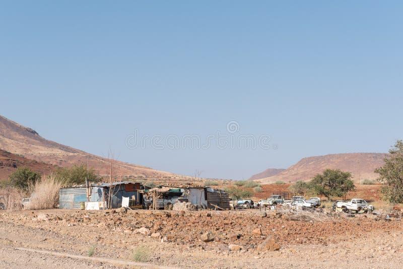 Street scene with shacks and car wrecks in Bergsig royalty free stock photos