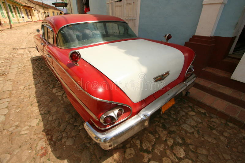 Old American car parked on side of road. An old Chevrolet parked along a back street in the city of Trinidad, Cuba royalty free stock photos