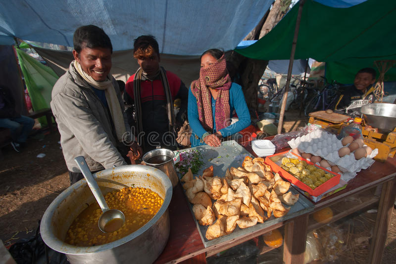Street seller cooking in nepali fair stock images
