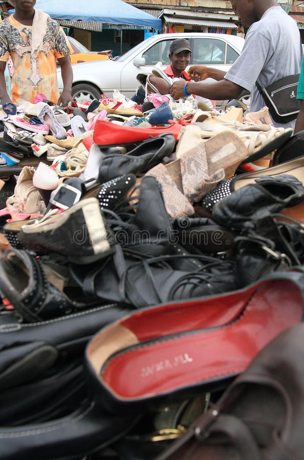 Street seller of shoes on an African market, Ghana. Central market in Cape Coast, coastal town and one of the largest agglomerations in Ghana (western Africa) royalty free stock photo
