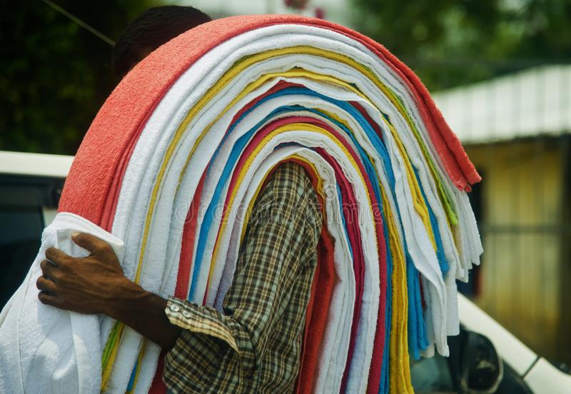 Street sellers carrying towels in shoulder around a street. S of India unique stock photo royalty free stock image