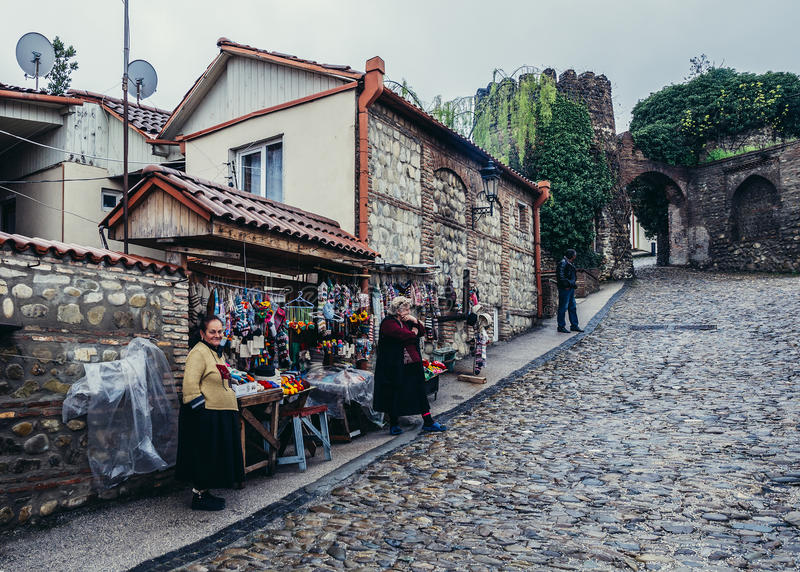 Street in Sighnaghi. Sighnaghi, Georgia - April 24, 2015. Souvenirs sellers in Sighnaghi, small town in Kakheti district stock photography