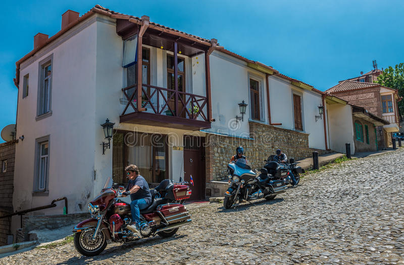 Street in Sighnaghi. Sighnaghi, Georgia - July 19, 2015. Man rides bike on the paved road in Sighnaghi, small town in Kakheti district of Georgia stock photos