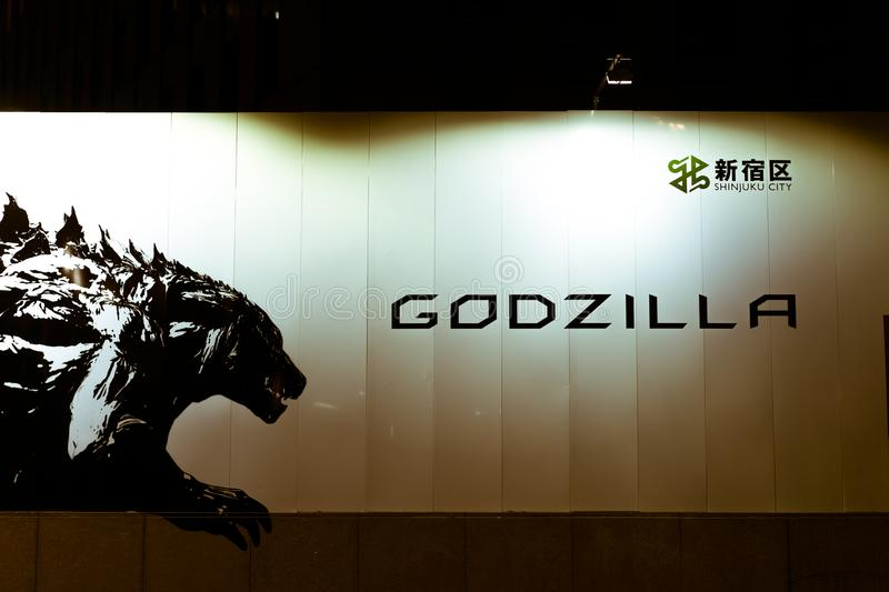 Street sign advertising for a new `Godzilla` movie in Shinjuku, Tokyo, Japan. Godzilla: Planet of the Monsters is a 2017 Japanese CG anime kaiju film featuring stock images