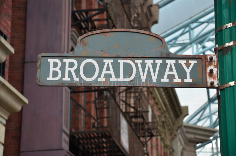 Street sign on the corner of Broadway royalty free stock image