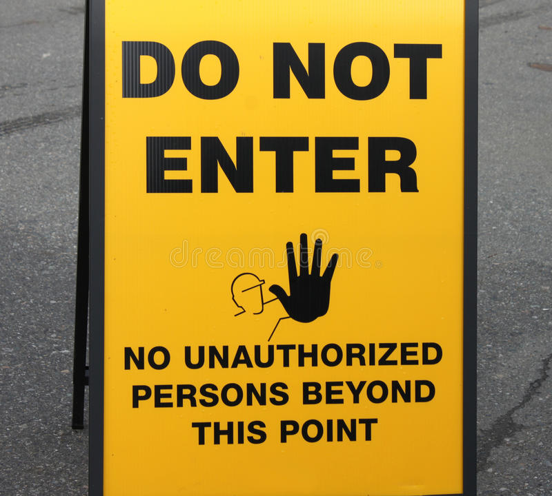 Street Sign Declaring. Yellow Street Sign Declaring Do Not Enter - No Unauthorized Persons Beyond This Point royalty free stock images