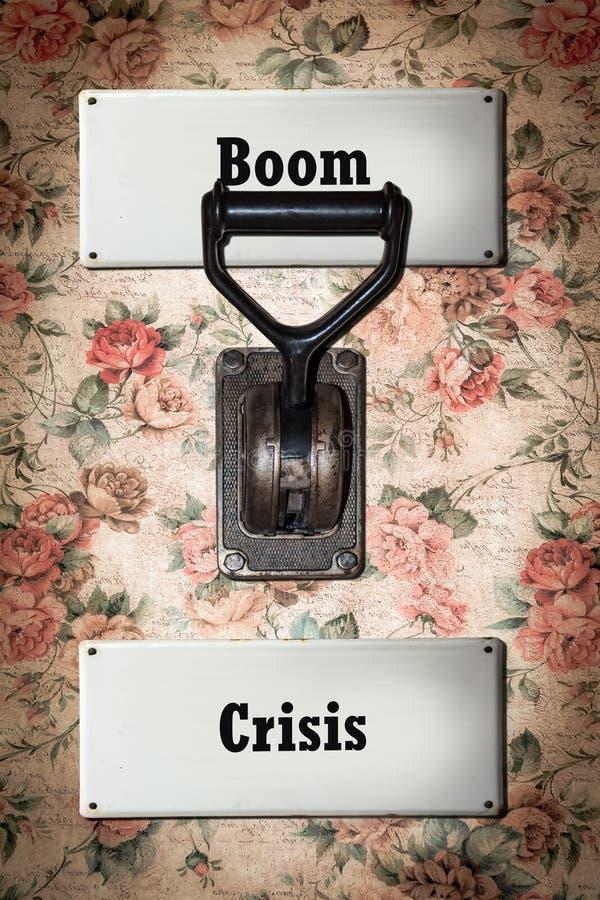 Street Sign Boom versus Crisis. Street Sign the Direction Way to Boom versus Crisis stock image