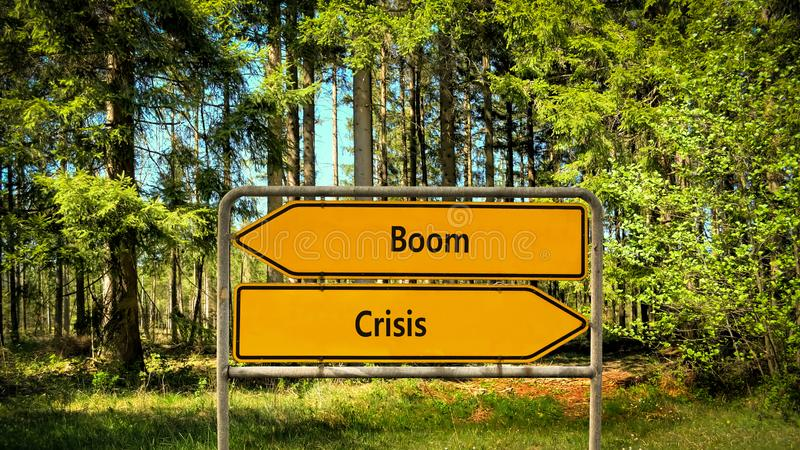 Street Sign Boom versus Crisis. Street Sign the Direction Way to Boom versus Crisis royalty free stock photos