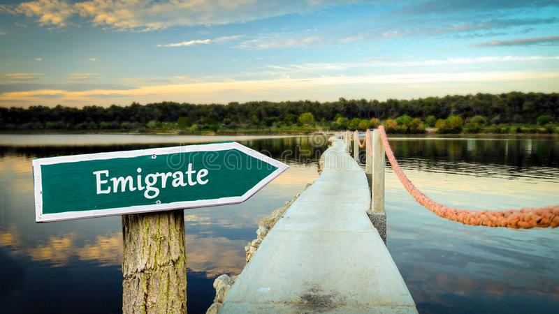 Street Sign to Emigrate stock photo