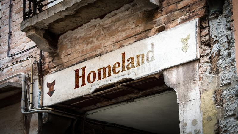 Street Sign to Homeland. Street Sign the Direction Way to Homeland royalty free stock image