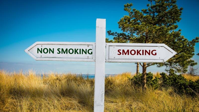 Street Sign Smoking versus Non Smoking. Street Sign the Direction Way to Smoking versus Non Smoking stock photos