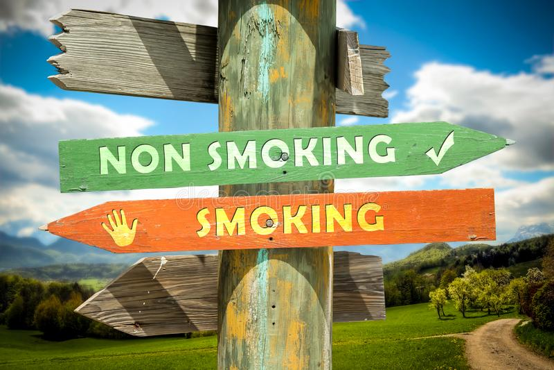 Street Sign Smoking versus Non Smoking. Street Sign the Direction Way to Smoking versus Non Smoking royalty free stock image