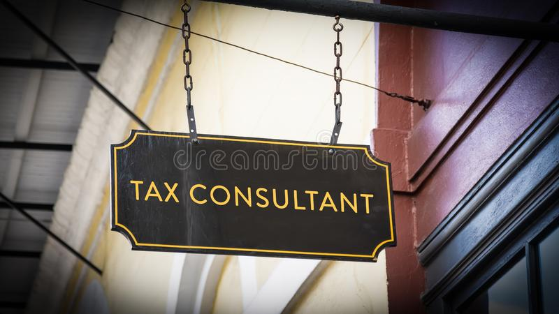 Street Sign to TAX CONSULTANT. Street Sign the Direction Way to TAX CONSULTANT royalty free stock image
