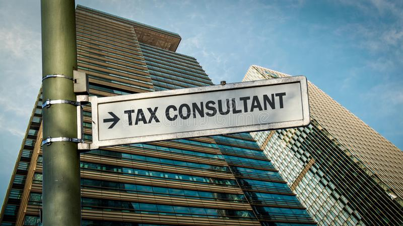Street Sign to TAX CONSULTANT. Street Sign the Direction Way to TAX CONSULTANT stock photos