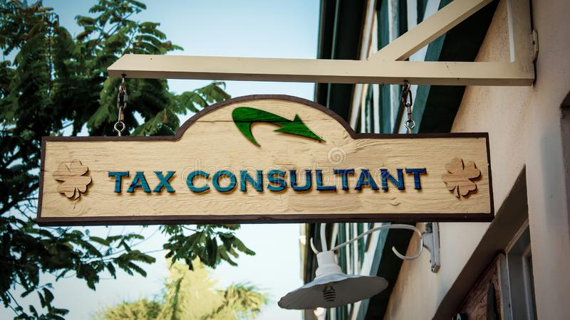 Street Sign to TAX CONSULTANT. Street Sign the Direction Way to TAX CONSULTANT stock photography