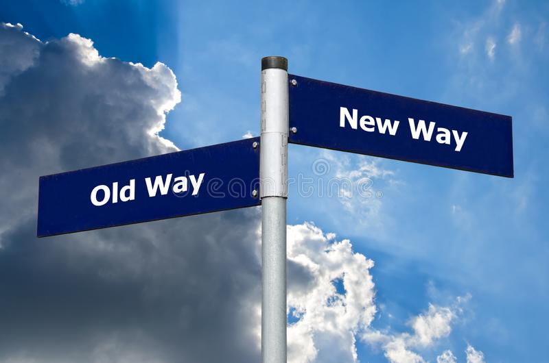 Street sign symbolizing choice between `old way` and `new way` stock image