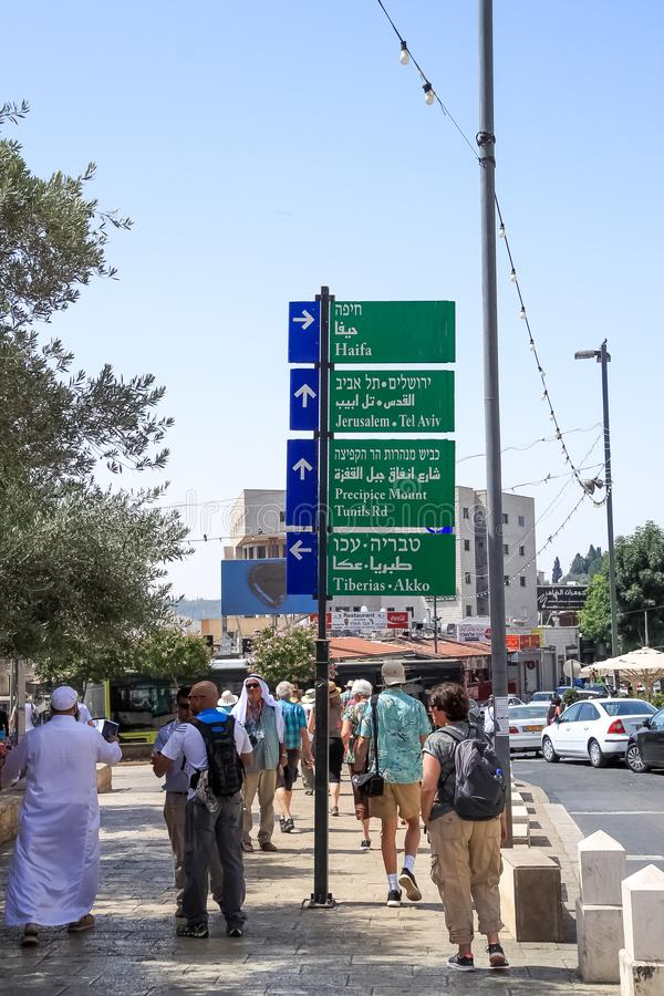Street sign in Haifa directing towards Jerusalem, Tel Aviv, Precipice Mount, Tiberias, Akko royalty free stock photo