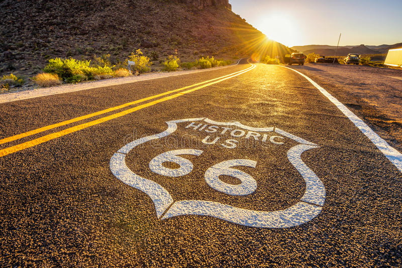 Street sign on historic route 66 in the Mojave desert. Photographed against the sun at sunset royalty free stock image