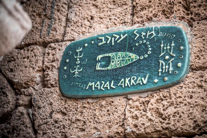 Street sign with horoscope signs in old city of Jaffa. Israel, Mazal Akrav - Scorpius royalty free stock photos