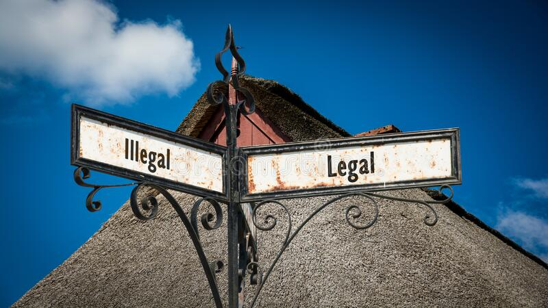 Street Sign Legal versus Illegal. Street Sign the Direction Way to Legal versus Illegal royalty free stock photos