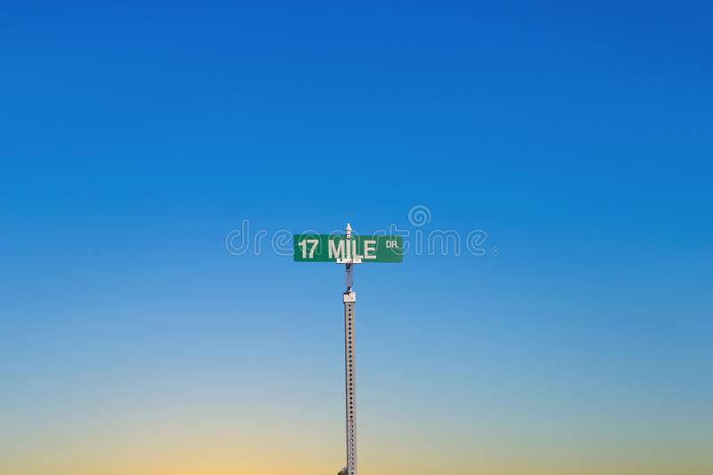 Street sign 17 Mile drive at  Pebble Beach near  Monterey in sunset light royalty free stock photography