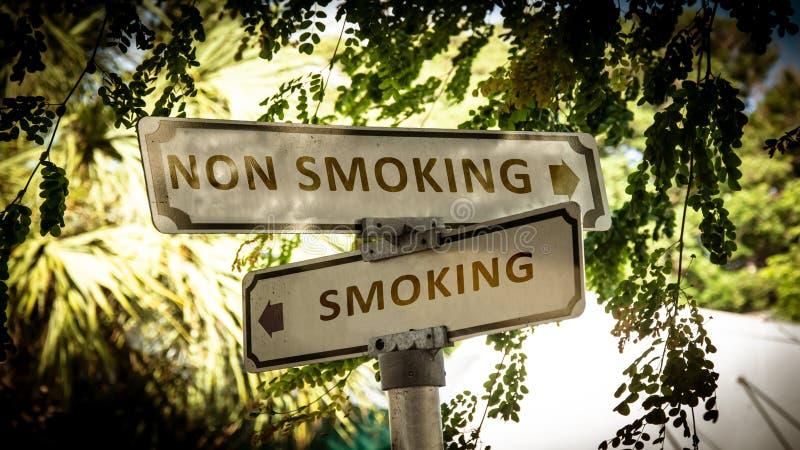 Street Sign Smoking versus Non Smoking. Street Sign the Direction Way to Smoking versus Non Smoking stock images