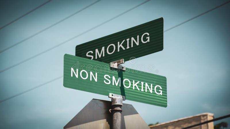 Street Sign Smoking versus Non Smoking. Street Sign the Direction Way to Smoking versus Non Smoking stock photo