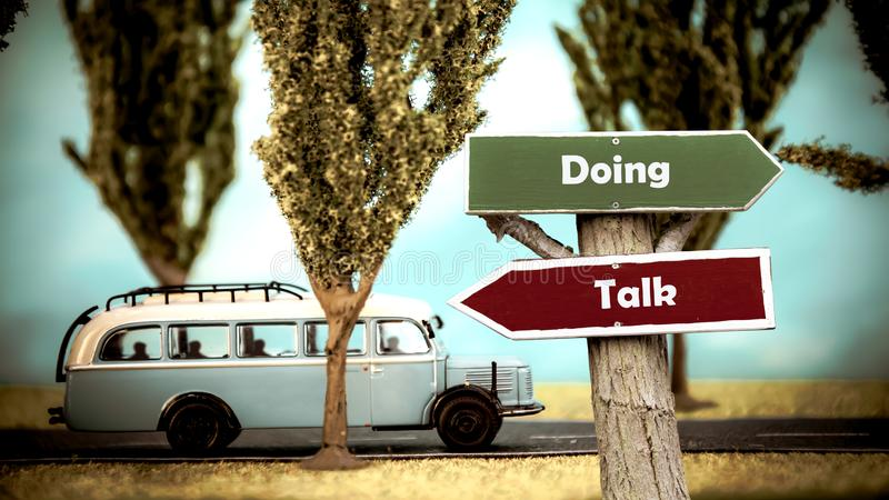 Street Sign to Doing versus Talk. Street Sign the Direction Way to Doing versus Talk stock image