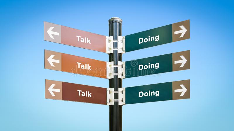 Street Sign to Doing versus Talk. Street Sign the Direction Way to Doing versus Talk royalty free stock images