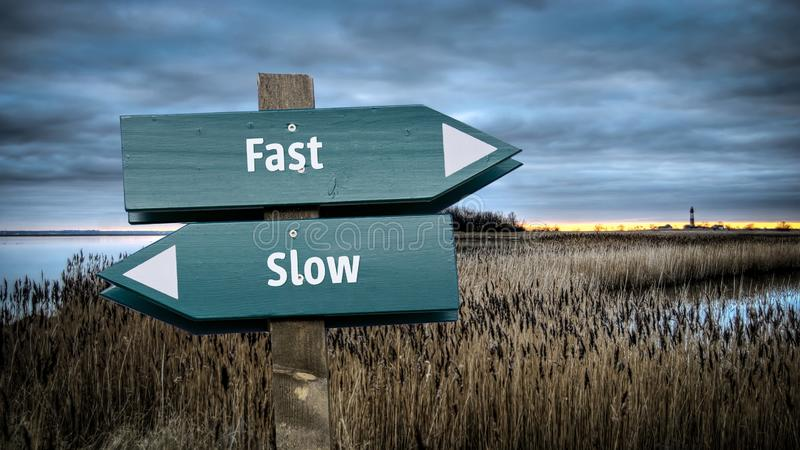 Street Sign to Fast versus Slow stock illustration