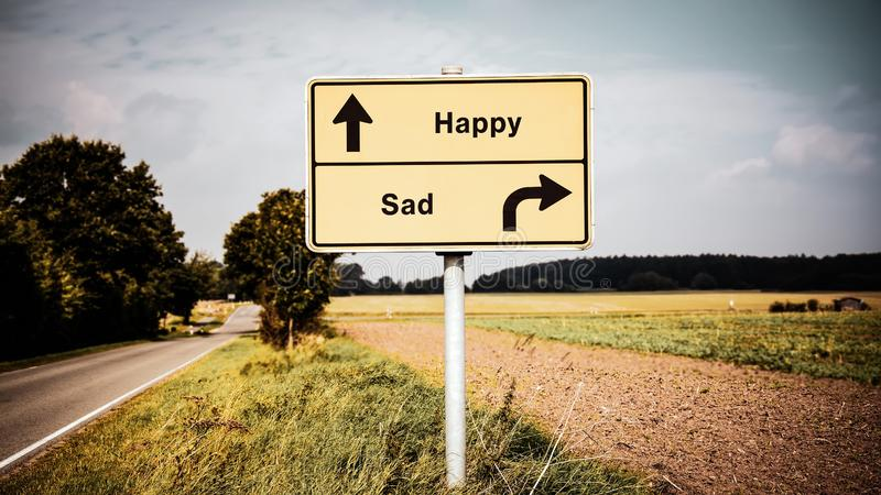 Street Sign to Happy versus Sad. Street Sign the Direction Way to Happy versus Sad royalty free stock photography