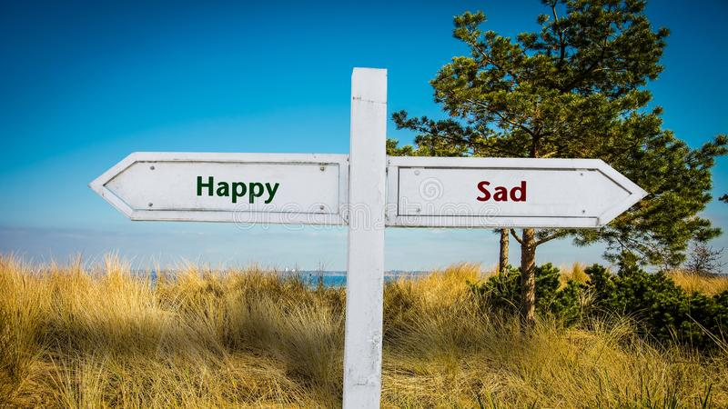 Street Sign to Happy versus Sad. Street Sign the Direction Way to Happy versus Sad royalty free stock images