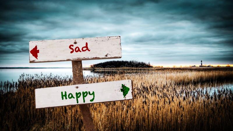 Street Sign to Happy versus Sad. Street Sign the Direction Way to Happy versus Sad royalty free stock photos