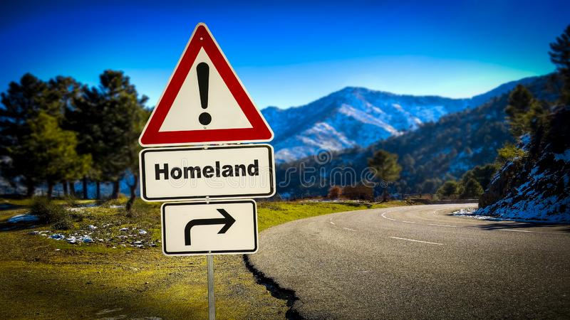 Street Sign to Homeland. Street Sign the Direction Way to Homeland stock photo