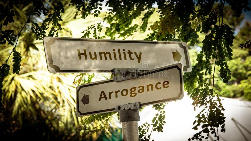 Street Sign to Humility versus Arrogance royalty free stock images