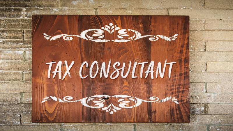 Street Sign to TAX CONSULTANT. Street Sign the Direction Way to TAX CONSULTANT royalty free stock photo
