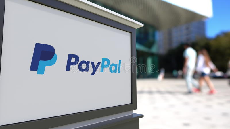 Street signage board with PayPal logo. Blurred office center and walking people background. Editorial 3D rendering. Street signage board with PayPal logo stock image