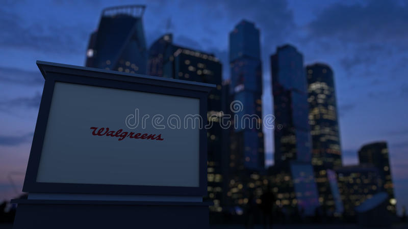 Street signage board with Walgreens logo in the evening. Blurred business district skyscrapers background. Editorial 3D royalty free stock image